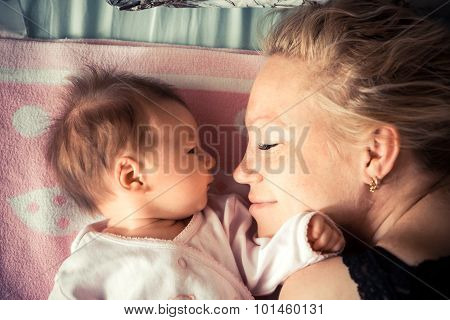 Mother with newborn baby sleeping