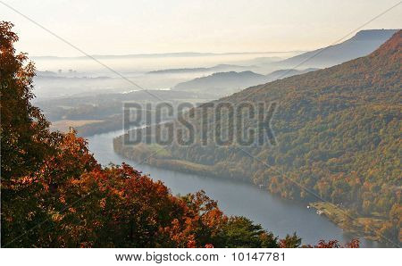 the skyline of Chattanooga rises in the distance as fog has settled in the Tennessee River Valley poster