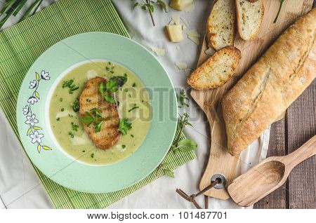 Creamy leek herby soup with toast toast baked on panini with little garlic and olive oil poster