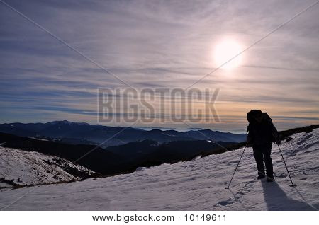 The tourist on an evening hillside.