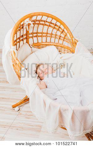 Baby girl sleeping in cradle