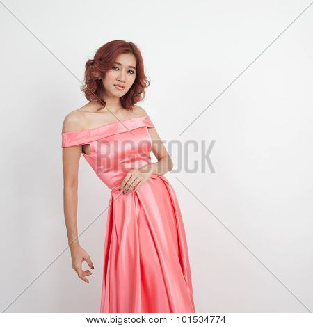 Half Portrait Of A Beautiful Girl In A Red Dress Isolated On Overwhite Background
