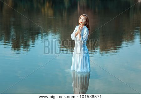 Girl Stands In The Water.