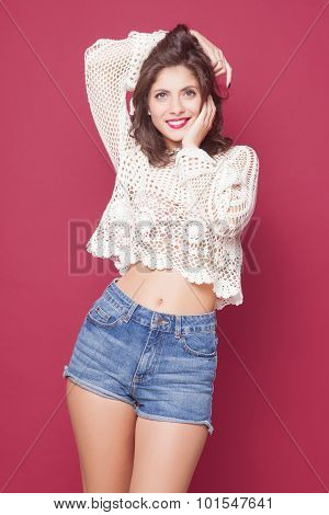 young happy beautiful girl posing grimacing in studio poster