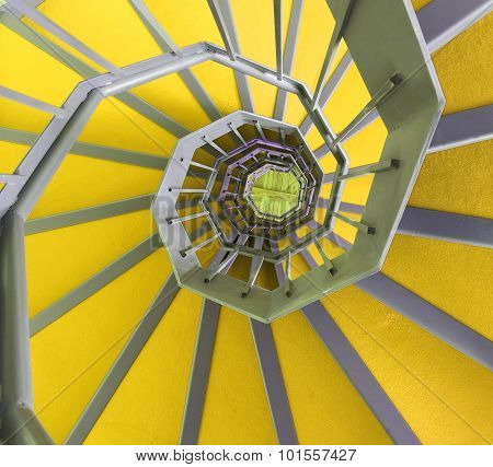 Long Spiral Staircase With Ywllow Carpet