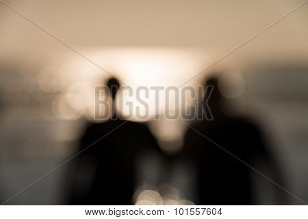 Defocused Silhouette Of People Around The Beach With Sunlight And Reflection In The Afternoon Abstra