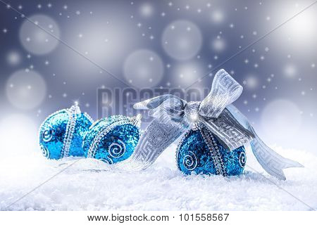 Christmas.Christmas blue balls and silver ribbon snow