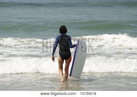 Woman Walking Into Water