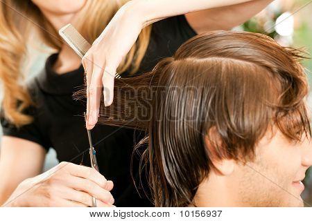 Man receiving haircut