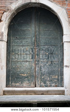 Wooden arched door in house