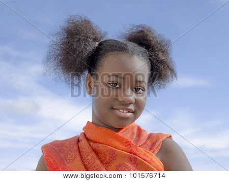 Afro girl with pigtails, ten years old
