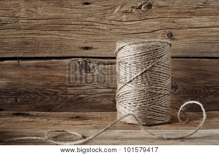 Coil Of Rope Twine On A Wooden Background Closeup