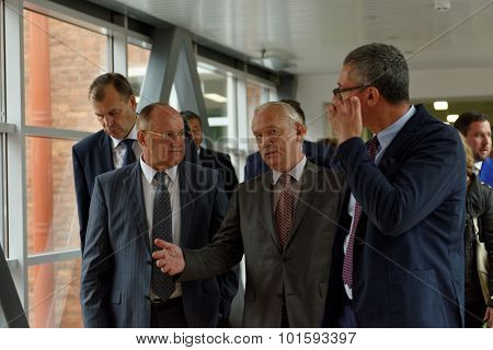 ST. PETERSBURG, RUSSIA - SEPTEMBER 3, 2015: First Vice-rector Alexander Shamrin (center) presents the new academic building of the Higher School of Economics. Local campus of HSE was founded in 1998