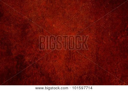 A textured red abstract background.