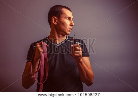 portrait of a man of European appearance holds a tourniquet and
