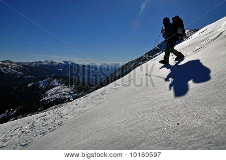 The tourist on a snow hillside