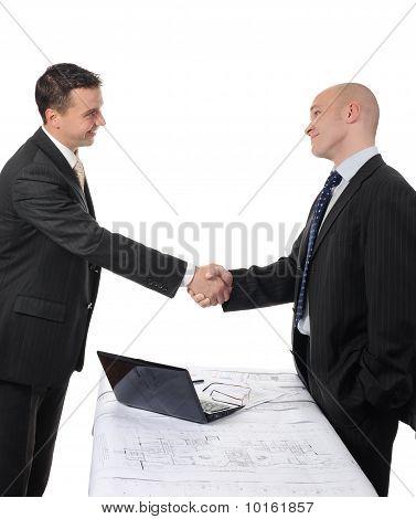 Handshake of two business partners