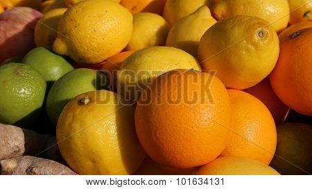 Ripe Orange And Yellow Sicilian Lemons And Green Lime