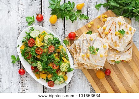 Mexican Quesadilla wrap with chicken, corn and sweet pepper and fresh salad.