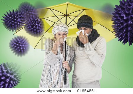 Couple sneezing in tissue while standing under umbrella against green vignette