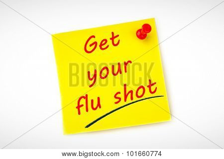 get your flu shot against yellow pinned adhesive note