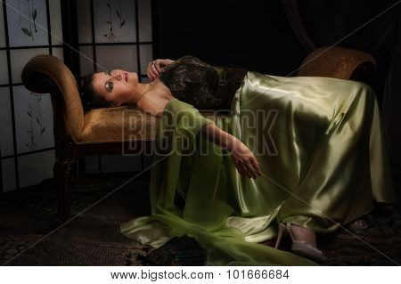 Elegant aristocratic lady in a luxurious boudoir poster