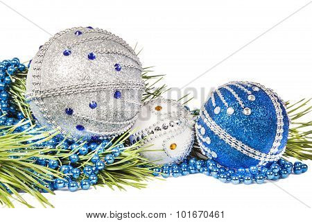 Christmas tree branch and blue with white glitter balls isolated