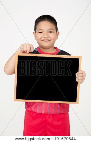 Little Asian Boy Holding Empty Wood Blackboard In Sport Unifrom