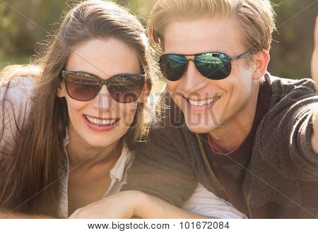 Couple wearing sunglasses taking a selfie together