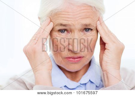 health care, pain, stress, age and people concept - face of senior woman suffering from headache poster