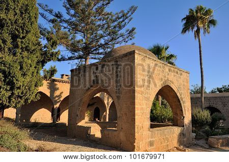 Courtyard of an ancient monastery Ayia Napa with a fountain under the dome Cyprus poster
