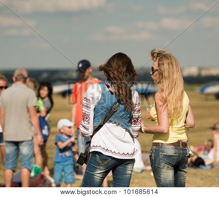 UKRAINE, KHARKIV -AUGUST 24: people watching airshow on Kharkiv aerodrome on Ukraine Independence Day  in Kharkiv on August 24, 2015