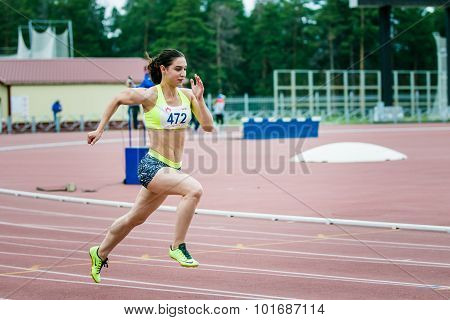 girl athlete running a sprint