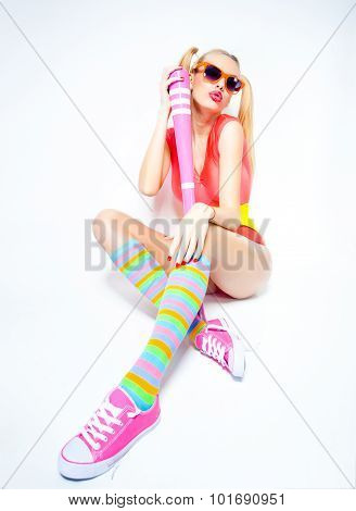 Sexy Baseball Girl Wearing Colorful Clothes Posing With A Baseball Bat