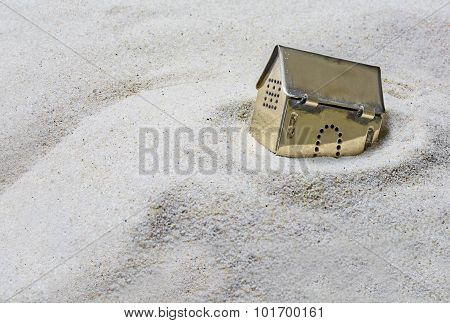 Small Golden Model House Sinking Into The Sand, Concept Of Risk In Real Estate