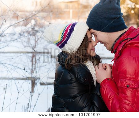 Outdoor Fashion Portrait Of Young Sensual Couple In Cold Winter Wather. Love And Kiss