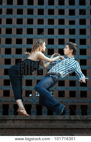 Young Couple Dancing The Tango.