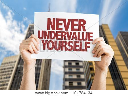 Never Undervalue Yourself placard with cityscape background