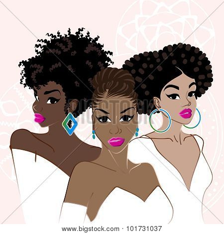 Three elegant dark-skinned women