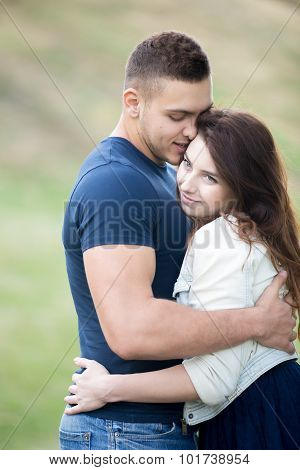 Young Couple On A Date In Park