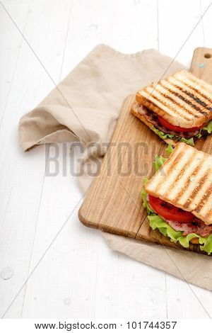 Food. Delicious BLT sandwich on the table