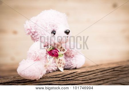Pink Teddy Bear Toy Alone On Wood In Front Brown Background