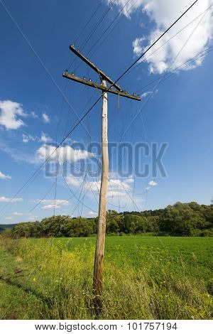 Old Unnecessary Wooden Electric's Pylon With Broken Wires
