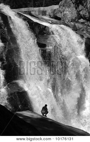 Hiker next to waterfall