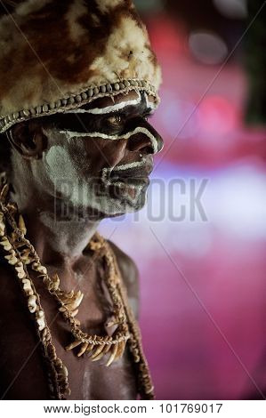 The Portrait Asmat warrior with a traditional paintin