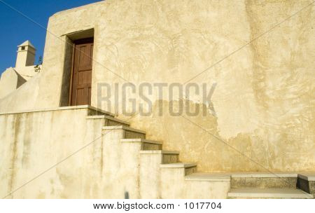 side entrance to accomodations at a monastry on the island of crete greece.