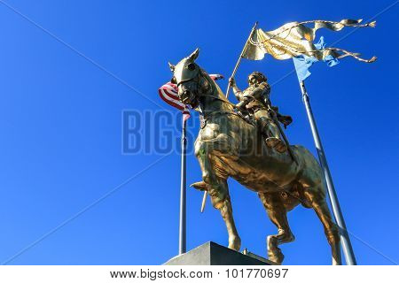 joan of arc statue with blue sky background at French Quarter, New Orleans, LA poster
