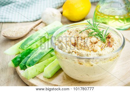 Bowl Of Classic Hummus Sprinkled With Paprika And Sesame