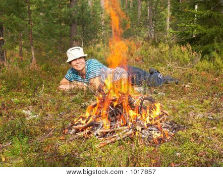 Happy Young Woman And Campfire