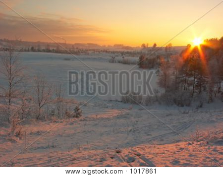 Snowy Sunset With Urban Background